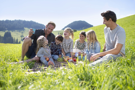 fathers with children enjoying countryside picnic
