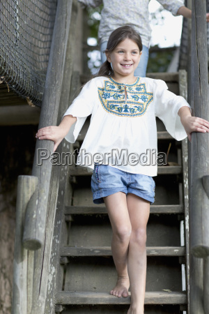 young girl climbing steps in adventure