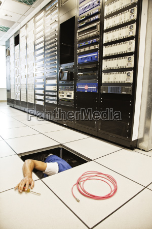 computer technician working on wiring systems