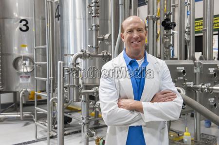 caucasian male technician in a white