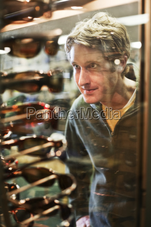 young caucasian male shopping for new