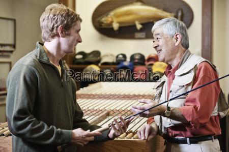 asian american senior male owner of