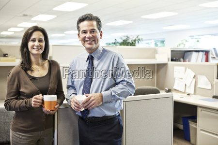 caucasian man and woman executives in
