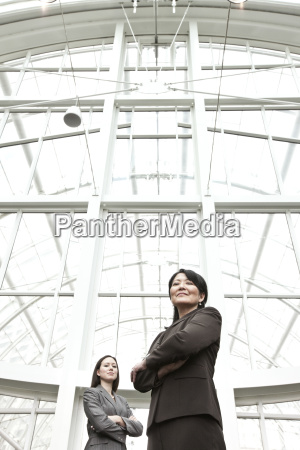asian business woman and caucasian