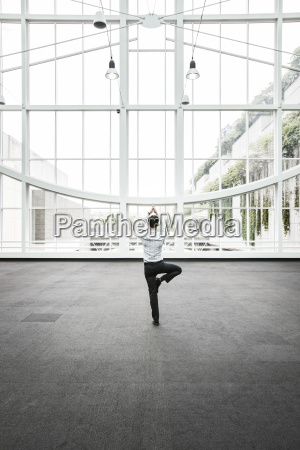 businessman relaxing doing a yoga pose