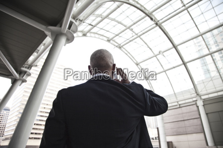 black businessman on the phone while