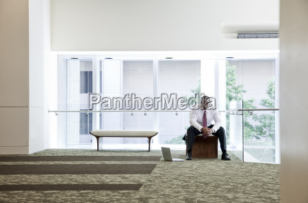 black businessman in lobby of large