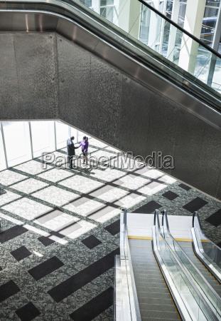 black businessman and woman meeting in