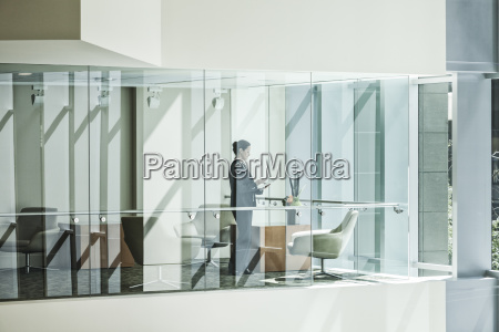 businesswoman standing in a conference room