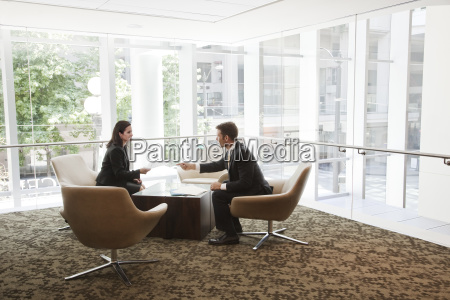 businessman and woman meeting at a