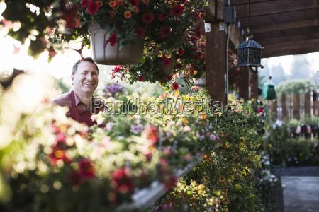 caucasian man a garden centre business