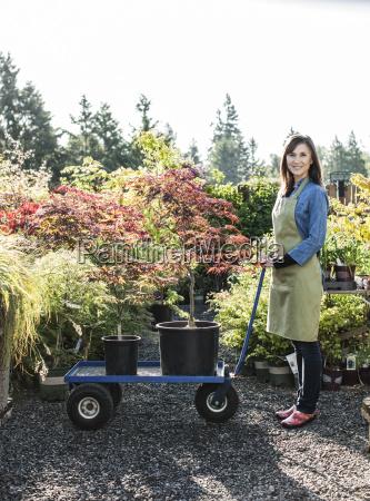 caucasian woman owner of a garden