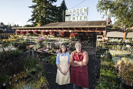 caucasian man and woman garden centre
