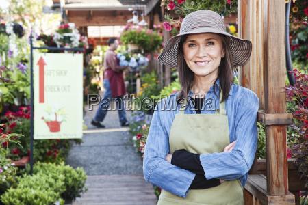 caucasian woman owner of garden centre