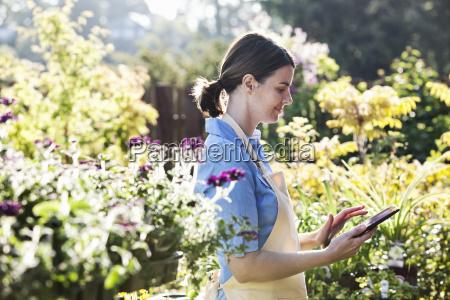 caucasian woman employee of a garden