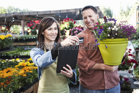caucasian man buying plants with a