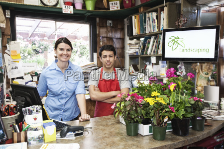 caucasian man and woman employees of