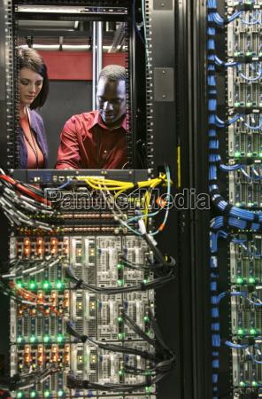 caucasian woman and black man technicians