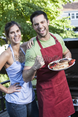 hispanic man and woman standing at