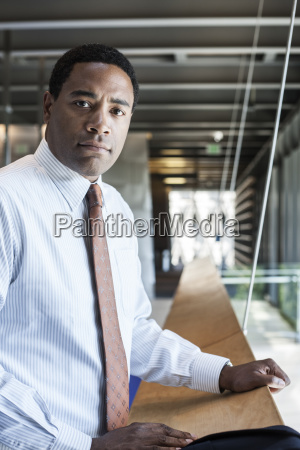 black businessman in the lobby of