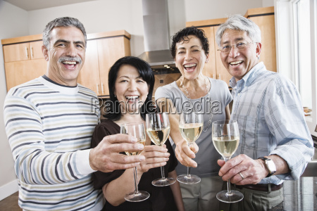 two couples in a kitchen asian