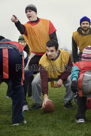 caucasian man playing quarterback for an