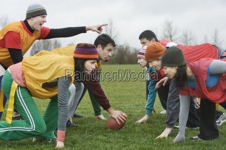 caucasian man playing quarterback for an