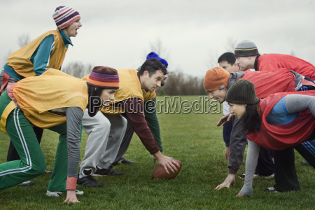 caucasian woman playing quarterback for a