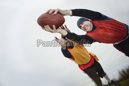 caucasian man being tackled by an