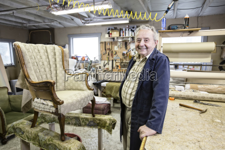 caucasian senior male upholsterer working on