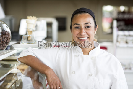 portrait of hispanic woman owner of