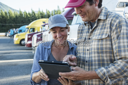 caucasian woman and man truck driving