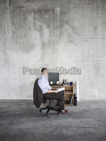 business man sitting at a small