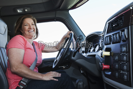 caucasian woman driver in the cab