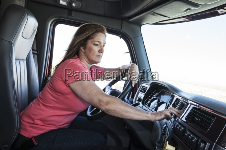caucasian woman driver parked and using