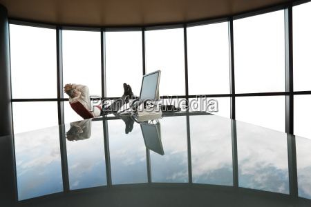 a businessman at his reflective office