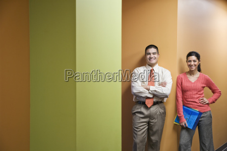 businessman and woman standing in a