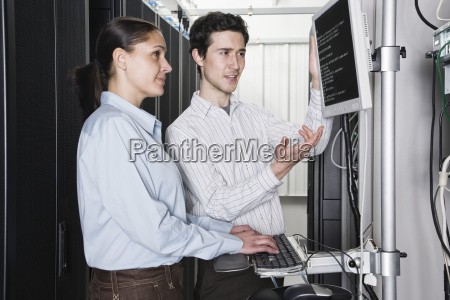 caucasian man and woman computer technicians