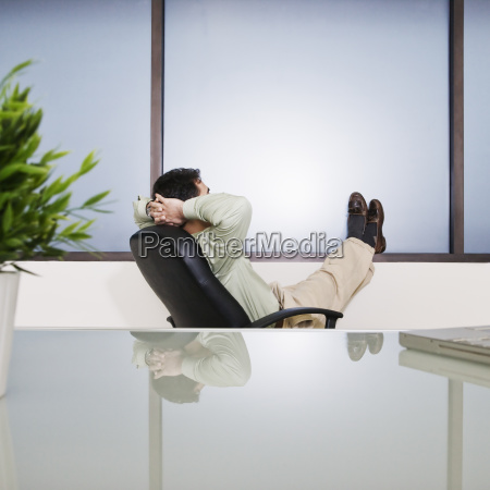 businessman with his feet up relaxing