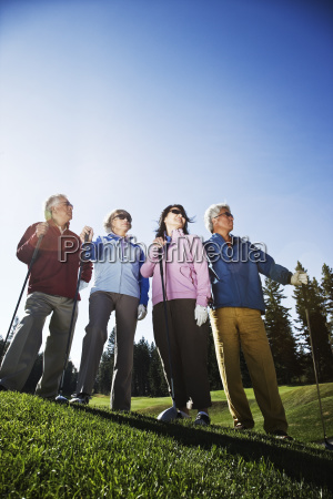 two young senior golfing couples on