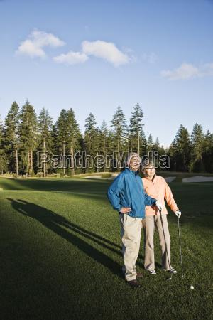 senior golfing couple on the golf