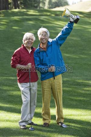 two senior male golfing buddies with