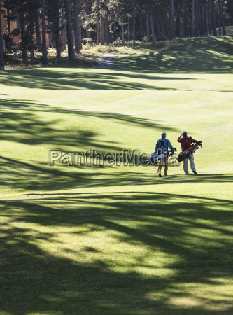two golfers surveying the next shot