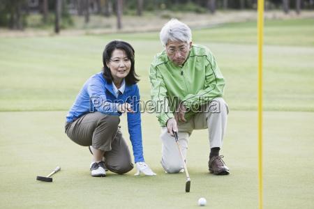 asian senior couple taking a look