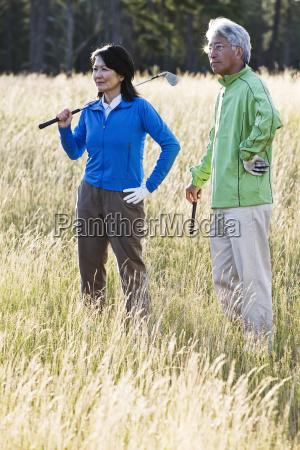 a young senior woman surveys her