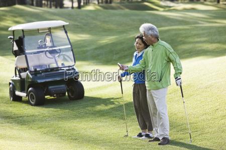 an asian senior couple checking the