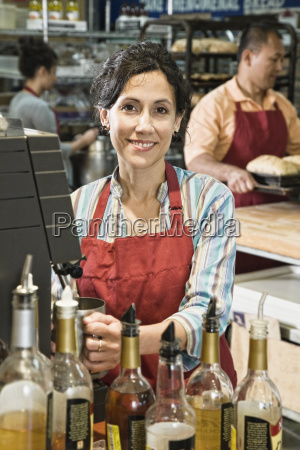 hispanic woman at the cash register