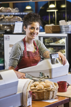 caucasian woman employee at the cash