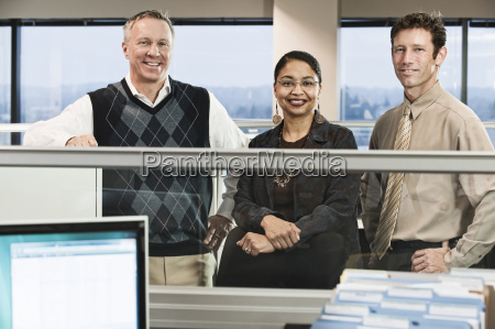mixed race team of three business