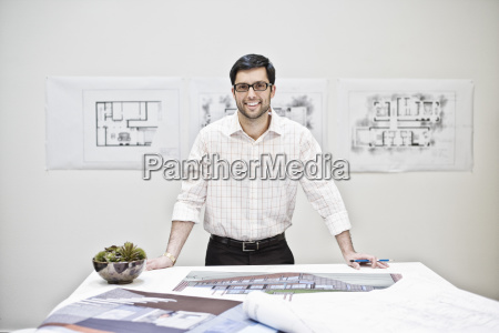 hispanic man working in an architects